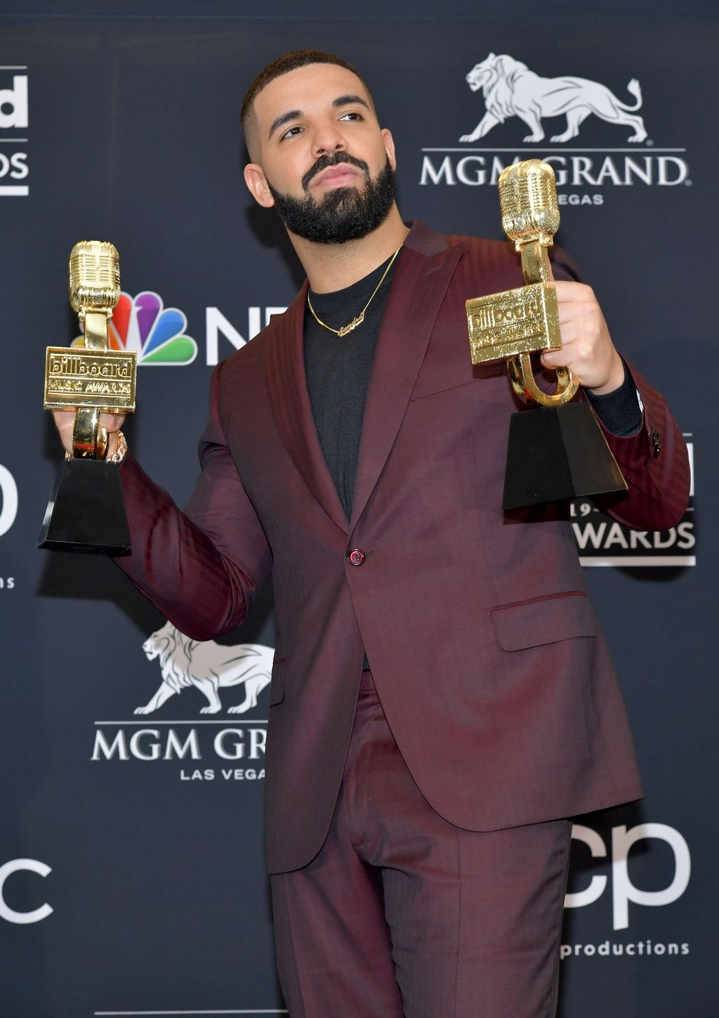 "LAS VEGAS, NEVADA - MAY 01: Drake poses with the awards for Top Artist, Top Male Artist, Top Billboard 200 Album for ""Scorpion"", Top Billboard 200 Artist, Top Hot 100 Artist, Top Streaming Songs Artist, Top Song Sales Artist, Top Rap Artist, Top Rap Male Artist in the press room during the 2019 Billboard Music Awards at MGM Grand Garden Arena on May 01, 2019 in Las Vegas, Nevada. (Photo by Amy Sussman/Getty Images for dcp)"