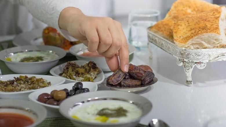 ramadan food and praying woman