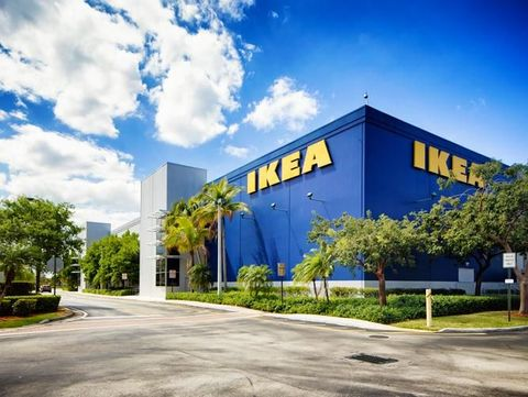 Corner view of the Ikea furniture store in Sunrise Florida near Fort Lauderdale on a mostly sunny Winter day. The image features the typical blue store with the yellow logo on its wall.