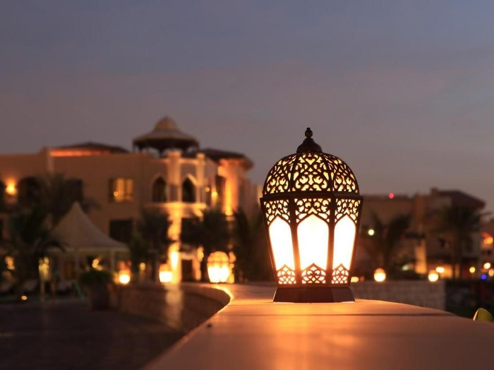 An arabesque lantern lamp Symbol of Ramadan times, also a famous Middle eastern (specially in morocco and Egypt) lighting decoration item..Some copy space was left up to fit greeting or title textMore Similar and Arabia Related..