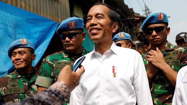 Loreng-loreng Pengawal Jokowi di Aksi 22 Mei