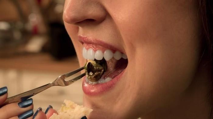 Ilustrasi makan siput mentah. Foto: iStock