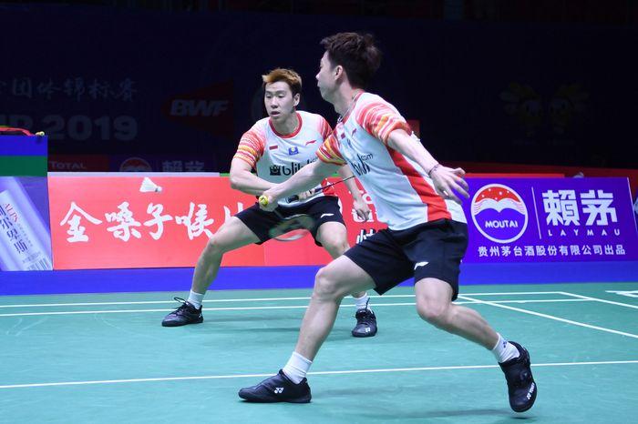 Ganda putra Indonesia Kevin Sanjaya Sukamuljo/Marcus Fernaldi Gideon dan Lee Yang/Wang Chi-Lin bertanding di partai pertama yang dihelat di Guangxi Sports Center Gymnasium, Jumat (24/5/2019) pagi WIB.