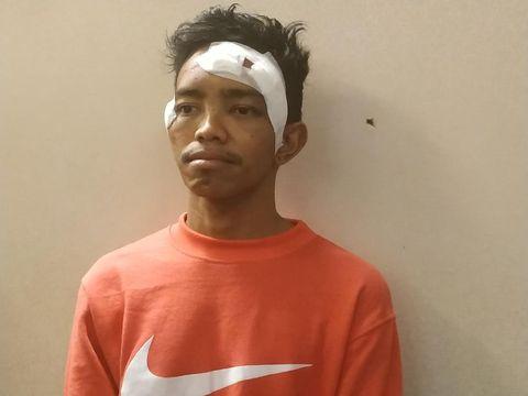 A alias Andri Bibir (30) yang dipukuli Brimob beberapa personel Brimob di dekat Masjid Al-Huda, Kampung Bali