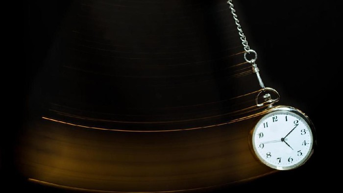 A pocket watch swinging.