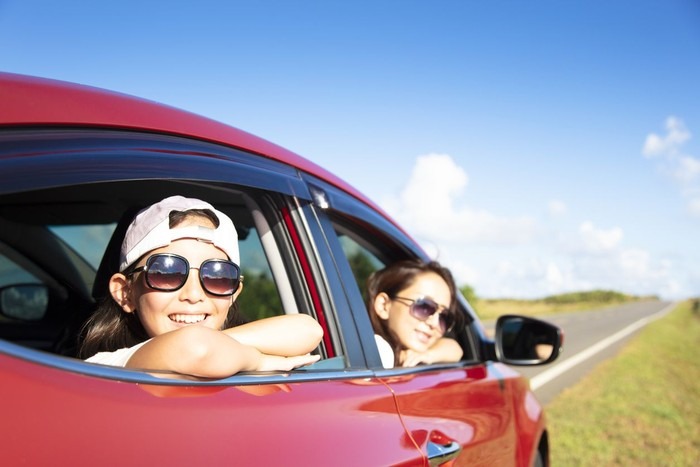Happy mother and daughter enjoy road trip