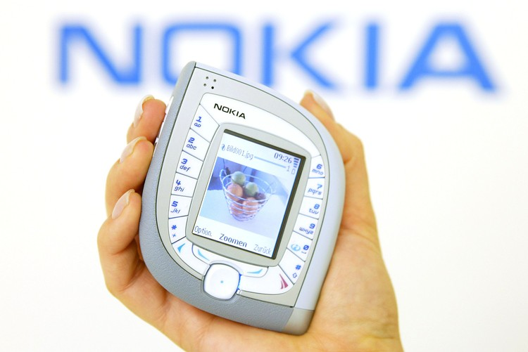 HANOVER, GERMANY - MARCH 18:  A model holds the new Nokia 7600 mobile phone at the CeBIT technology trade fair March 18, 2004 in Hanover, Germany. The 7600 is both UMTS and GMS standard capable. This year a total of 6,411 exhibitors are taking part in the seven-day fair.     (Photo Sean Gallup/Getty Images)