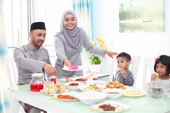 A Malay Muslim family having Hari Raya Aidlfitri/ Eid-Ul-Fitr meals at their home on in Malaysia.