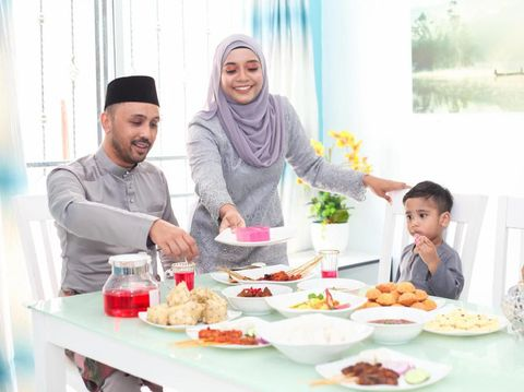 A Malay Muslim family having Hari Raya Aidlfitri/ Eid-Ul-Fitr meals at their home on in Malaysia.