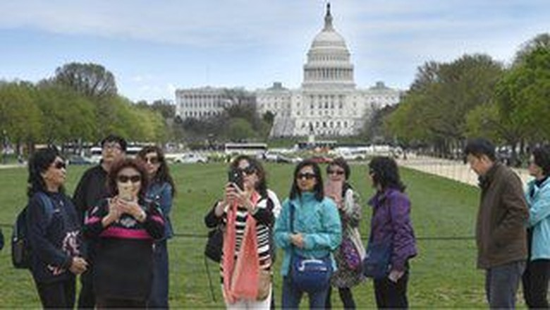 China Keluarkan Larangan Perjalanan ke AS Bagi Warganya
