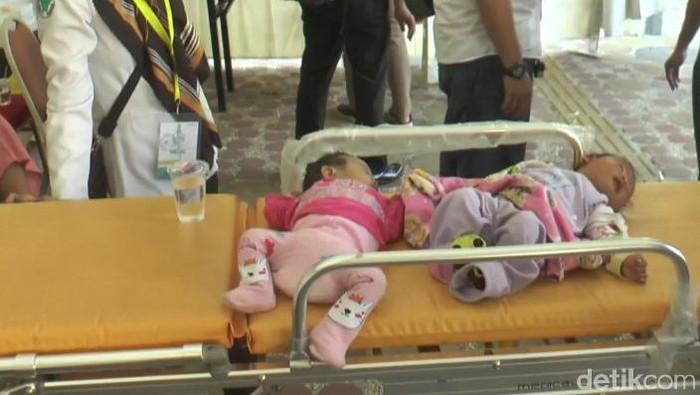 Foto: Bayi 3 bulan yang terpisah dari orang tua saat open house di kediaman JK di Makassaar (Reinhard-detikcom).