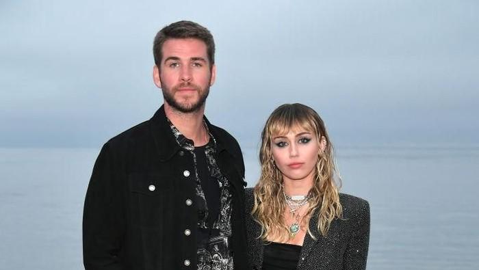Miley Cyrus dan Liam Hemsworth. Foto: Neilson Barnard/Getty Images