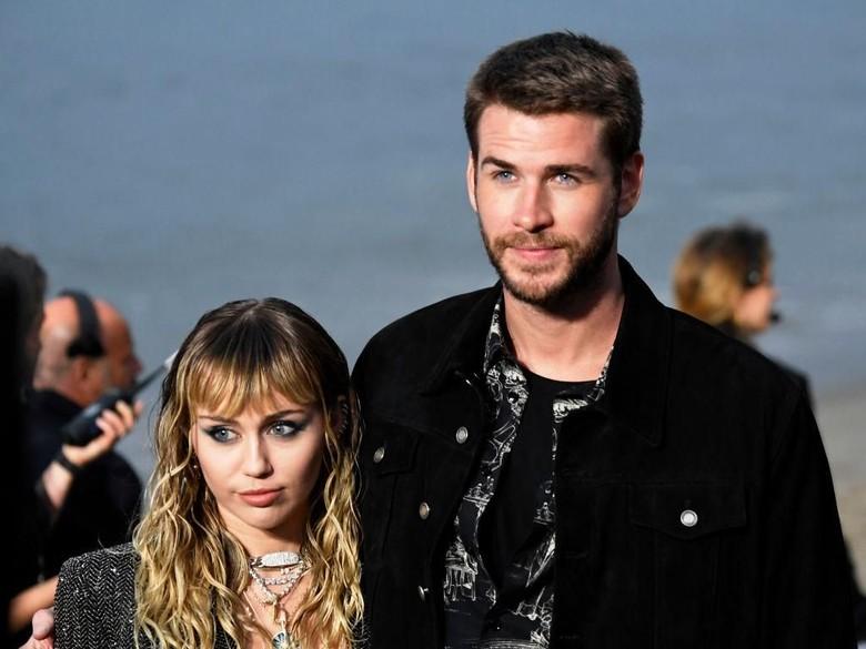 Foto: Miley Cyrus dan Liam Hemsworth (Getty Images/Neilson Barnard)
