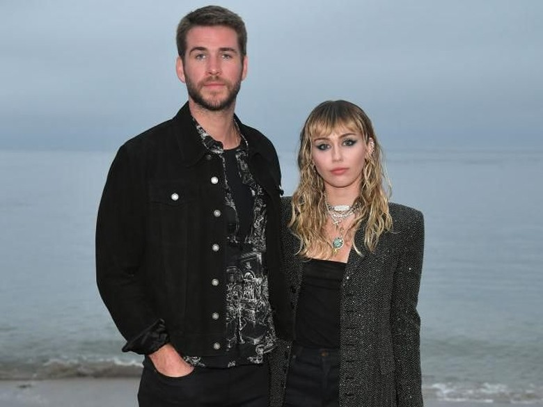 Foto: Miley Cyrus dan Liam Hemsworth (Getty Images/Neilson Barnard)