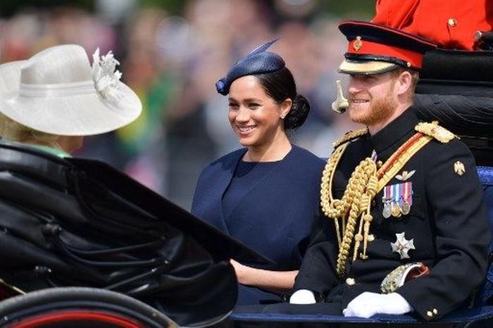 Pangeran Hary dan Meghan Markle. Foto: Daniel LEAL-OLIVAS / AFP
