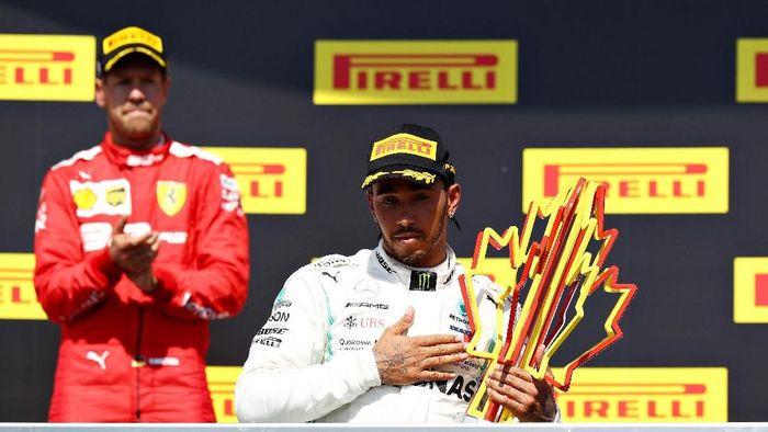 Lewis Hamilton makin kokoh berdiri di puncak klasemen pebalap F1 usai jadi pemenang GP Kanada (Mark Thompson/Getty Images)