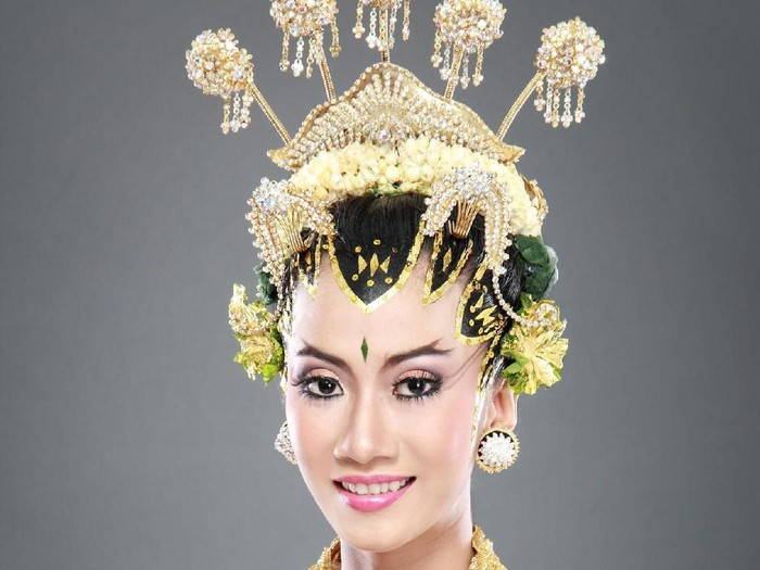 woman traditional wedding dress of java. studio portrait