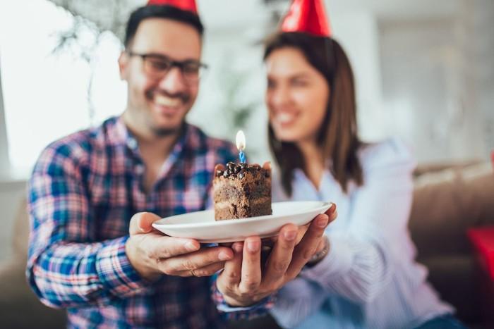 Husbands birthday.Wife surprise his husband with birthday cake .Anniversary.