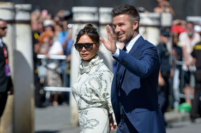 SEVILLE, SPAIN - JUNE 15: David Beckham and wife Victoria Beckham attend the wedding of real Madrid football player Sergio Ramos and Tv presenter Pilar Rubio at Sevilles Cathedral on June 15, 2019 in Seville, Spain. (Photo by Aitor Alcalde/Getty Images)