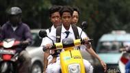 Jangan Ditiru! Aksi Pemotor Bonceng Tiga Marak di Jakarta