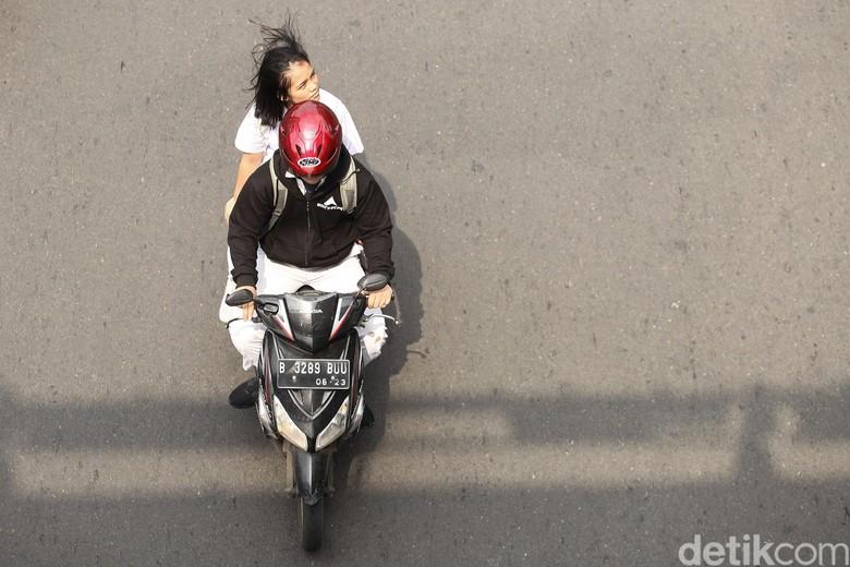 Ilustrasi tak memakai helm. Foto: Rifkianto Nugroho