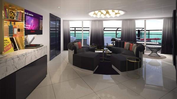 Ini Massive Suite. Ruang tamunya memiliki bar lengkap dan meja melingkar (Virgin Voyages/CNN)