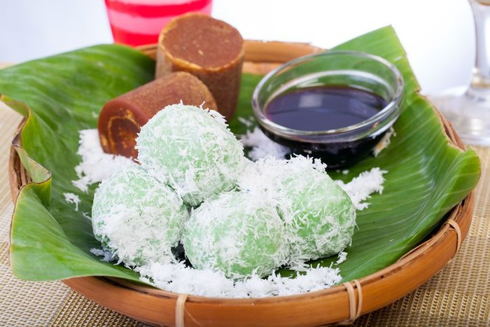 Indonesian Cuisine, Klepon or Traditional Pandanus Rice Balls Made From Glutinous Flour and Grated Coconut with Palm sugar Filling.