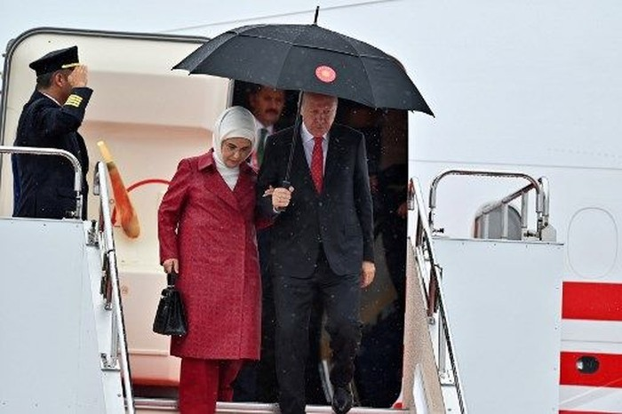Turkish President Recep Tayyip Erdogan and his wife Emine Erdogan arrive at Kansai airport in Izumisano city, Osaka prefecture, on June 27, 2019 ahead of the G20 Osaka Summit. (Photo by CHARLY TRIBALLEAU / AFP)