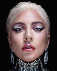 Lady Gaga memakai anting Rinaldy Yunardi untuk promo produk makeup terbarunya.