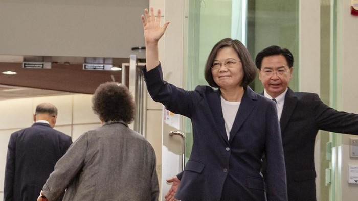 In this photo released by the Taiwan Presidential Office, Taiwanese President Tsai Ing-wen, waves as she leaves for the Caribbean from Taoyuan International Airport in Taoyuan, Taiwan on Thursday, July 11, 2019. President Tsai departed Thursday for a four-country state visit to the Caribbean with stops in the United States on the way there and back. (Taiwan Presidential Office via AP)