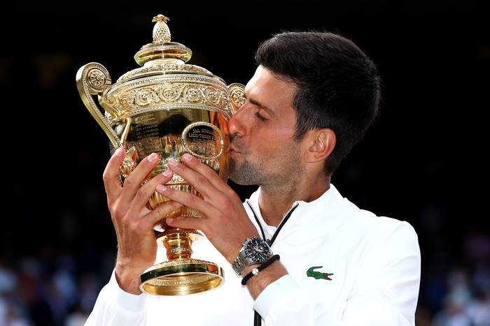 LONDON, ENGLAND - JULY 14:  Novak Djokovic of Serbia kisses the trophy after winning his Mens Singles final against Roger Federer of Switzerland during Day thirteen of The Championships - Wimbledon 2019 at All England Lawn Tennis and Croquet Club on July 14, 2019 in London, England. (Photo by Clive Brunskill/Getty Images)