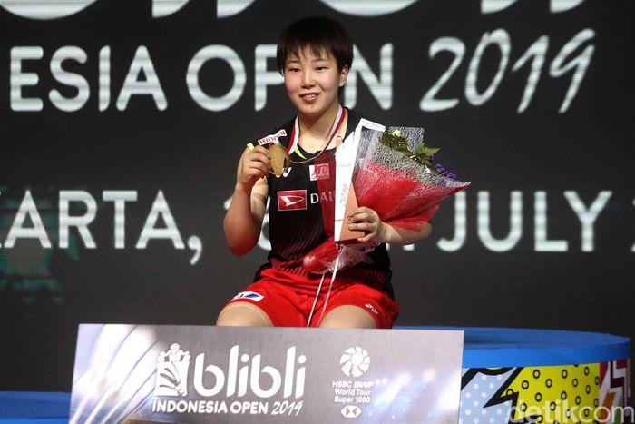 Akane Yamaguchi saat berjibaku di laga final Indonesia Open 2019.