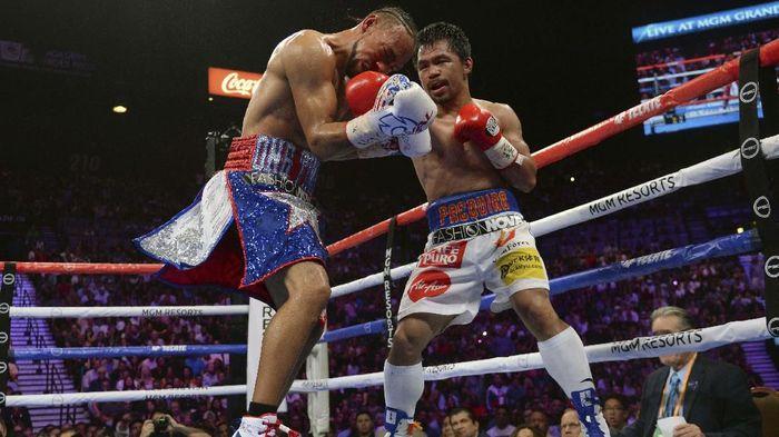 Manny Pacquiao mau saja melakukan rematch dengan Floyd Mayweather Jr (Joe Camporeale-USA TODAY Sports)