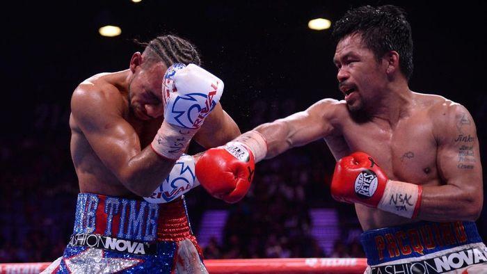 Petinju Manny Pacquiao meraih gelar WBA Super kelas welter. (Foto: Reuters)