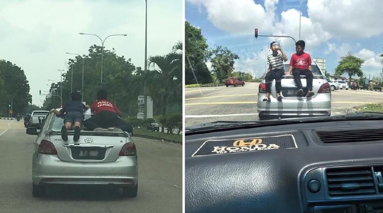 Nekat! 2 Bocah Bergaya Superman di Atas Mobil yang Melaju Kencang