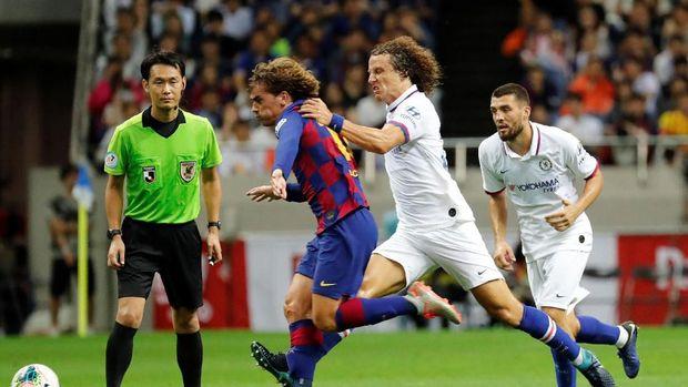 Antoine Griezmann bersaing dengan Lionel Messi dan Luis Suarez.