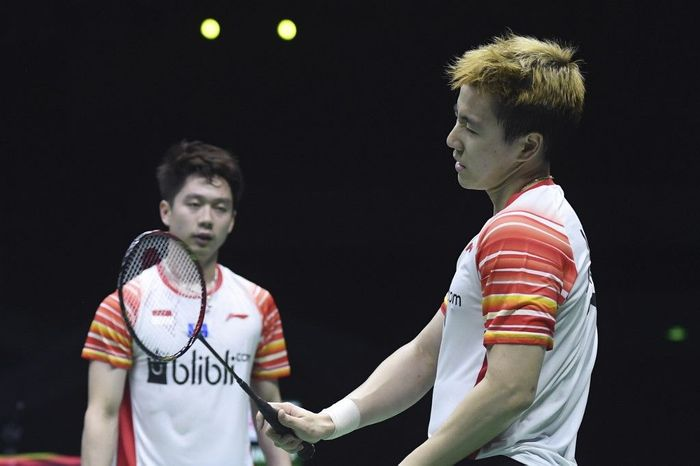 Indonesias Marcus Fernaldi Gideon and Kevin Sanjaya Sukamuljo (R) react after losing a point against Japans Takeshi Kamura and Keigo Sonoda during their mens doubles semi-final match at the 2019 Sudirman Cup world badminton championships in Nanning in Chinas southern Guangxi region on May 25, 2019. (Photo by WANG ZHAO / AFP)