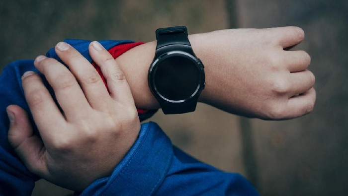 Smart watch on the boys hand-from above