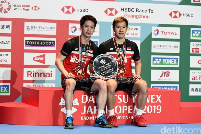 Kevin/Marcus menjuarai Japan Open 2019. Ini jadi gelar ketiga mereka di turnamen tersebut. Matt Roberts/Getty Images.