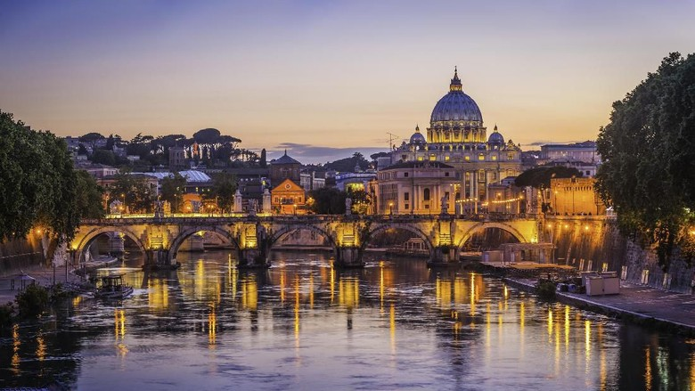 Iconic landmarks of Rome, Italys ancient capital city, reflecting in the tranquil waters of the River Tiber. ProPhoto RGB profile for maximum color fidelity and gamut.