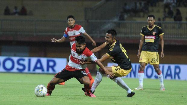 Madura United kalah 0-1 dari Bali United.