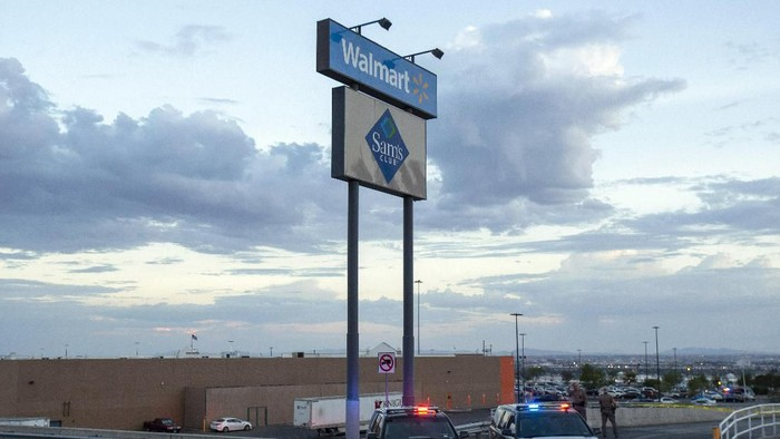 Texas state police cars block the access to the Walmart store in the aftermath of a mass shooting in El Paso, Texas, Saturday, Aug. 3, 2019. Multiple people were killed and one person was in custody after a shooter went on a rampage at a shopping mall, police in the Texas border town of El Paso said. (AP Photo/Andres Leighton)