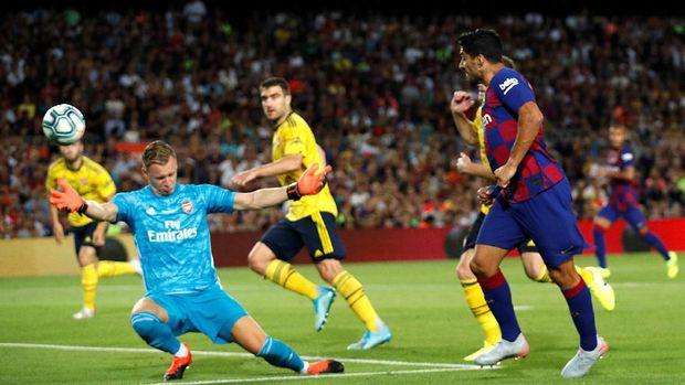 Luis Suarez (kanan) bakal jadi andalan bagi Barcelona melawan Valencia.