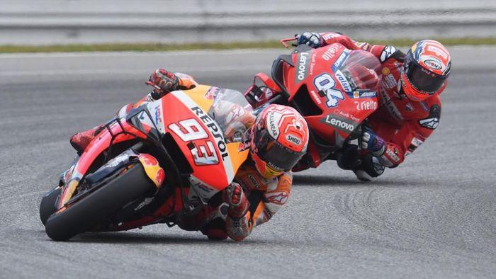 Andrea Dovizioso menilai gap antara Marc Marquez dan para pebalap MotoGP lainnya terlalu besar (Foto: Michal Cizek / AFP)
