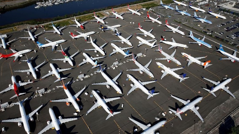 Dozens of grounded Boeing 737 MAX aircraft are seen parked in an aerial photo at Boeing Field in Seattle, Washington, U.S. July 1, 2019. Picture taken July 1, 2019. REUTERS/Lindsey Wasson