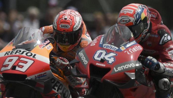 Marc Marquez dan Andrea Dovizioso akan melanjutkan rivalitas di MotoGP San Marino (VLADIMIR SIMICEK / AFP)