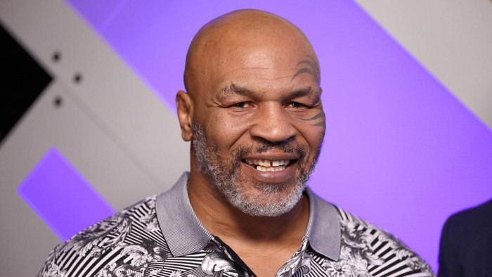 BURBANK, CALIFORNIA - JANUARY 18: (EDITORIAL USE ONLY. NO COMMERCIAL USE) Mike Tyson speaks with Mario Lopez at Capital One Podcast Studio during the 2019 iHeartRadio Podcast Awards Presented by Capital One at the iHeartRadio Theater LA on January 18, 2019 in Burbank, California.   Rich Polk/Getty Images for iHeartMedia/AFP