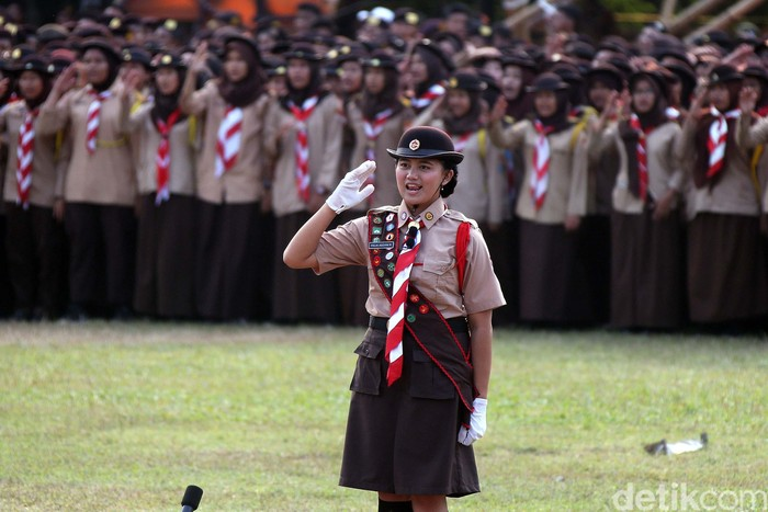 Presiden Joko Widodo menghadiri peringatan Hari Pramuka ke-58 di Bumi Perkemahan Wiladatika Cibubur, Jaktim. Tak hanya itu, terlihat juga Presiden ke-5 RI, Megawati.