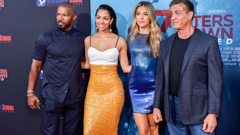 Adu Gaya Seksi Putri Jamie Foxx dan Sylvester Stallone di Karpet Merah