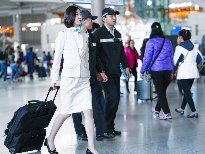 Incheon, South Korea - February 15, 2016: Asian Korean female air flight attendant in International airport of Incheon. It is one of the largest and busiest world airports.